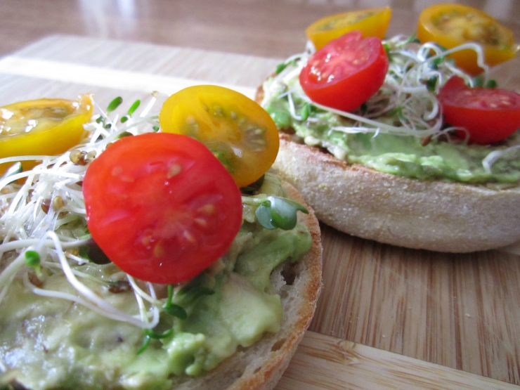 Healthy Clean Eating English Muffin Sandwich with Avocado, Cherry Tomatoes and Brussel Sprouts