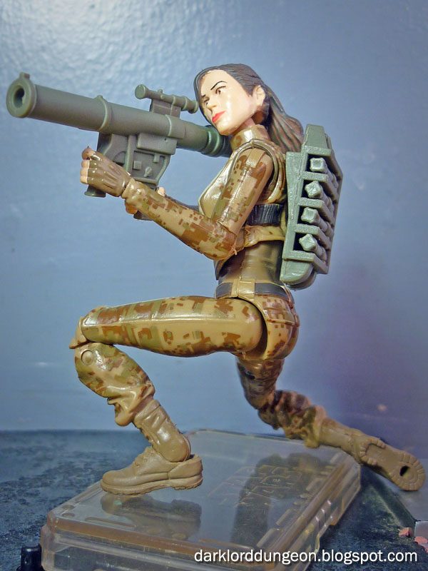 Here she is with her submachine guns. note the flexibility and