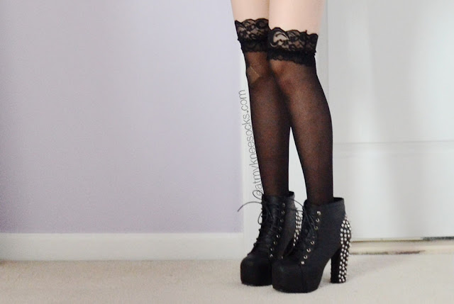 More photos of the lace-trim sheer silk socks from Dresslink, paired with spiked platform booties.