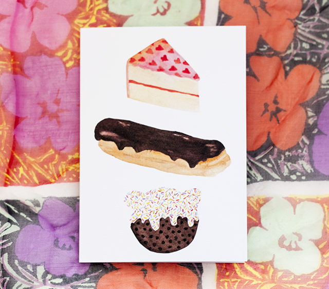 print of watercolour painting of cake, chocolate eclair and chocolate chip cookie with sprinkles
