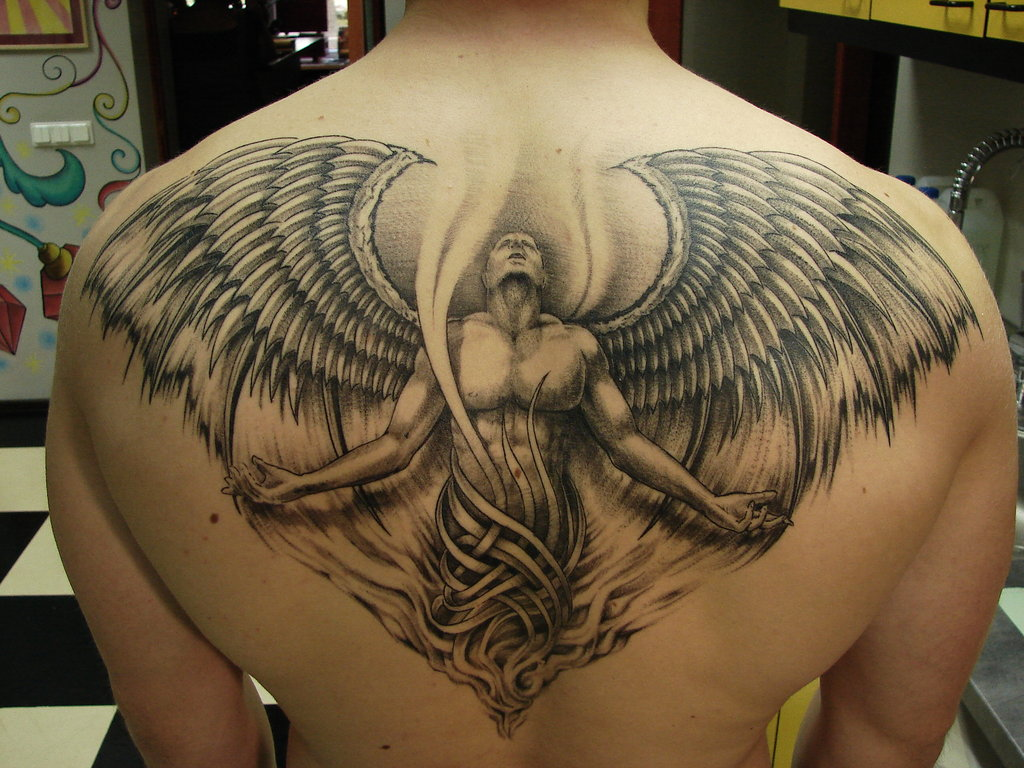 free tattoo pictures angel tattoos definition and design. Black Bedroom Furniture Sets. Home Design Ideas