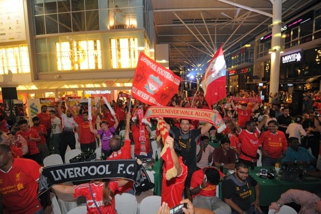 Liverpool fans cheering away for their team