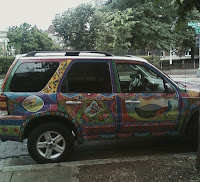 side view of car with bright painted designs on doors and roof