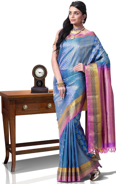 Shop online for sarees and wedding sarees, bandhni sari, traditional indian saris, zari, silk, printed, bandhej and embroidered saris of latest designs and styles.