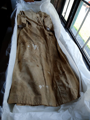 Edison's lab coat before treatment by Art Conservator and historic textile expert, Gwen Spicer