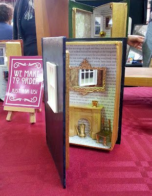Miniature room in a book box on a market stall.