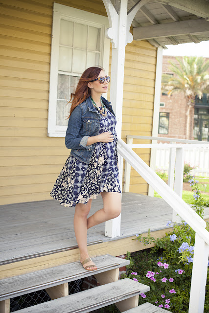 Amy West in Anthropologie swing dress, jean jacket, sunglasses, and necklace