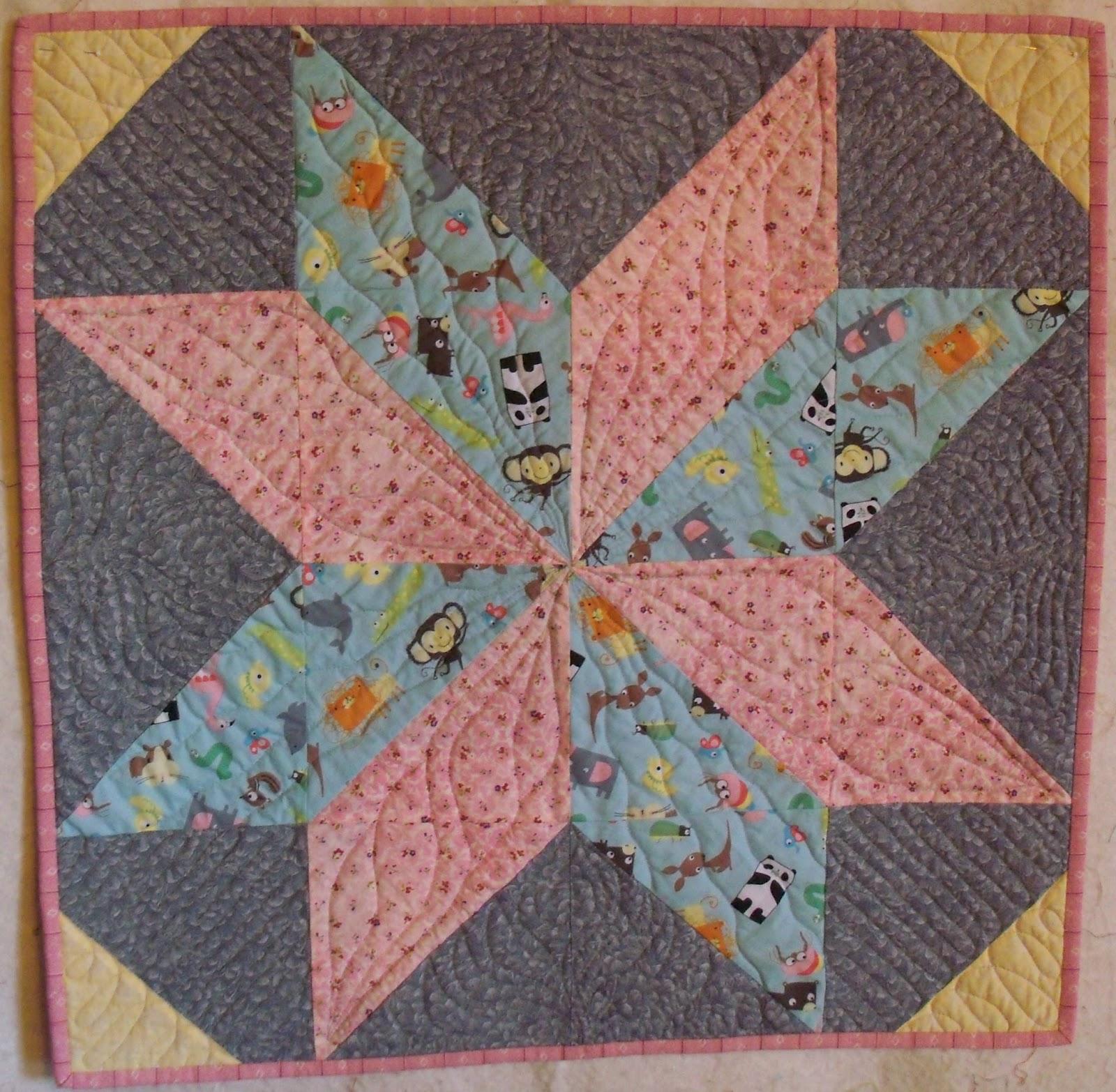 http://3.bp.blogspot.com/-GiBsJSR4npg/UWmbs3aIWaI/AAAAAAAACG8/vWT7VZVvXCA/s1600/Big+Star+Doll+Quilt.jpg