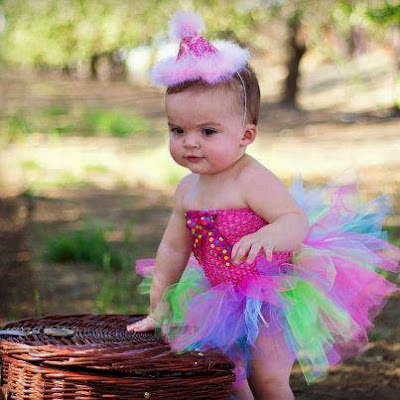 Beautiful Baby Girl Acting Serious with Funny Dress
