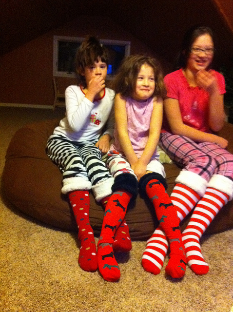 Family tradition: Wear silly Christmas socks on Christmas Adam and watch your favorite Christmas movie together. #overstuffedlife