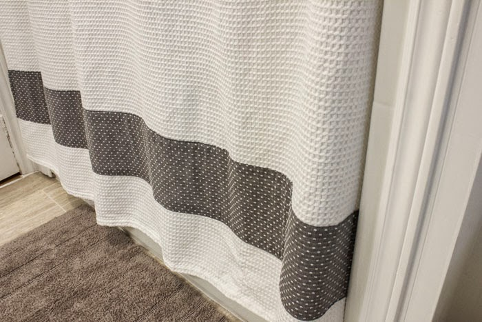 adding design to a shower curtain