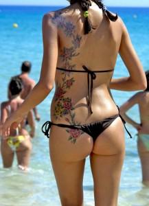 http://3.bp.blogspot.com/-GjTbS68J1P4/Te0PEyMnNFI/AAAAAAAAAcI/_mkLMgFQPDA/s1600/Flower-Lily-Vine-Back-Tattoo-Designs.jpg