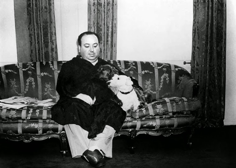 Alfred Hitchcock at home with his dogs. 1940.