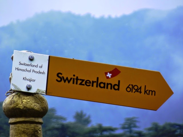 Signboard indicating distance of Switzerland