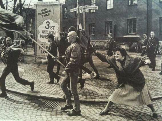 52 photos of women who changed history forever - A Swedish woman hitting a neo-Nazi protester with her handbag. The woman was reportedly a concentration camp survivor. (1985)