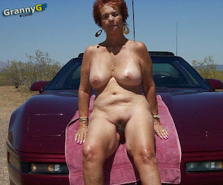 older granny posing naked in front of car