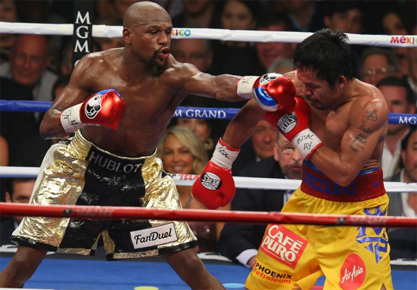 Floyd Mayweather Decisions Manny Pacquiao (VIDEO)