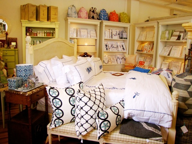 COCOCOZY Vent  and Fence pillows as part of a bedroom display