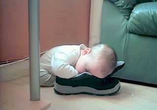 Funny picture: sleeping baby in a shoe
