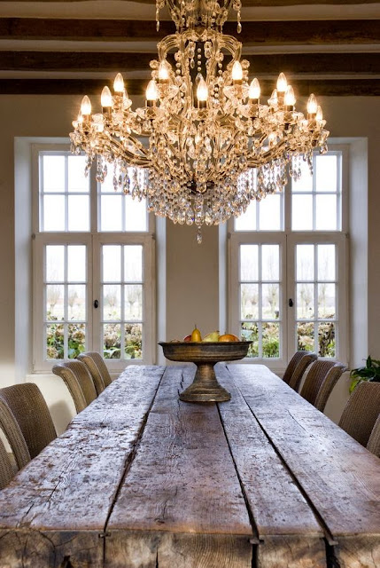 rustic plank dining table with ornate crystal chandelier
