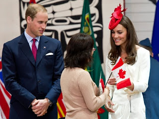William and Kate, the Duke and Duchess of Cambridge greet a new Canadian citizen during a citizenship ceremony Friday, July 1, 2011, in Gatineau, Canada.