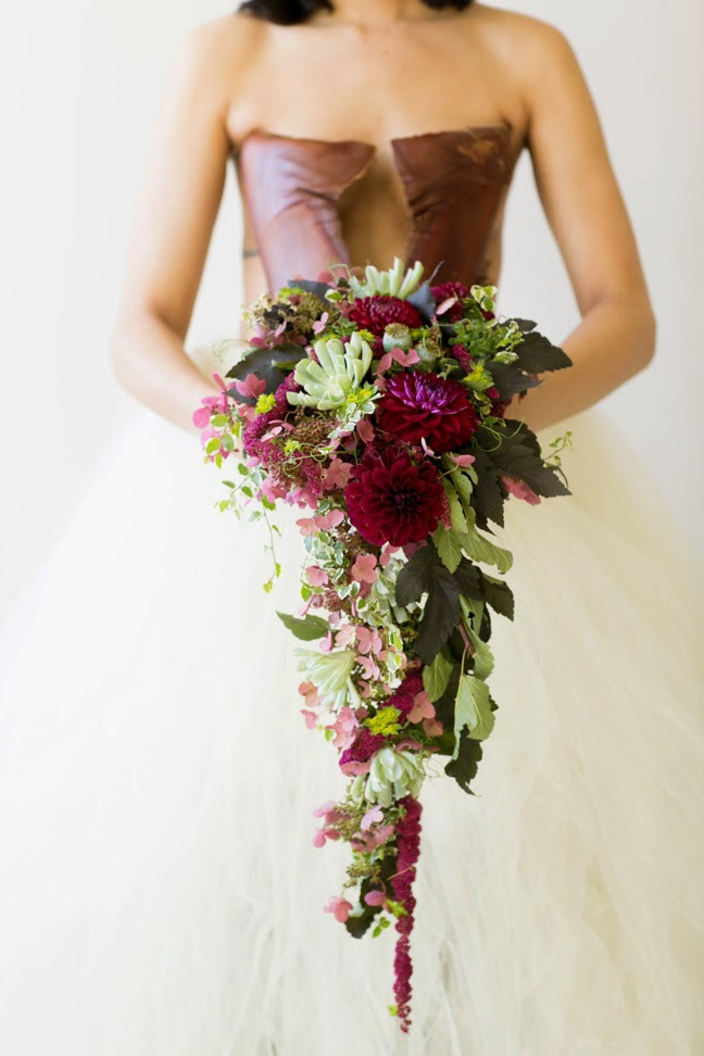 cascading plum mint forest blush and sage textured bridal bouquet by sweet pea floral design ann arbor wedding florist featuring succulents dahlia lace hydrangea wild asymmetrical textured bridal bouquet vines