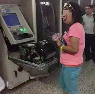 chinese woman rips apart atm with bare hands