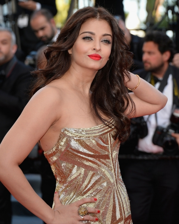 Bollywood actress Aishwarya Rai Bachchan was radiant in this gold Roberto Cavalli embellished gown.
