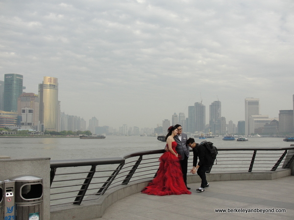 Chinese wedding couple on Bund in Shanghai, China