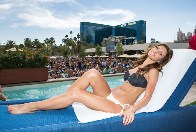 Audrina Patridge relaxes on the blue sofa at Wet Republic in Las Vegas