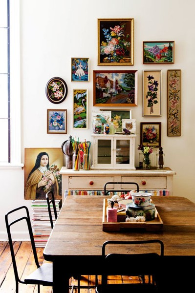 A collection of vintage prints and needlepoint.