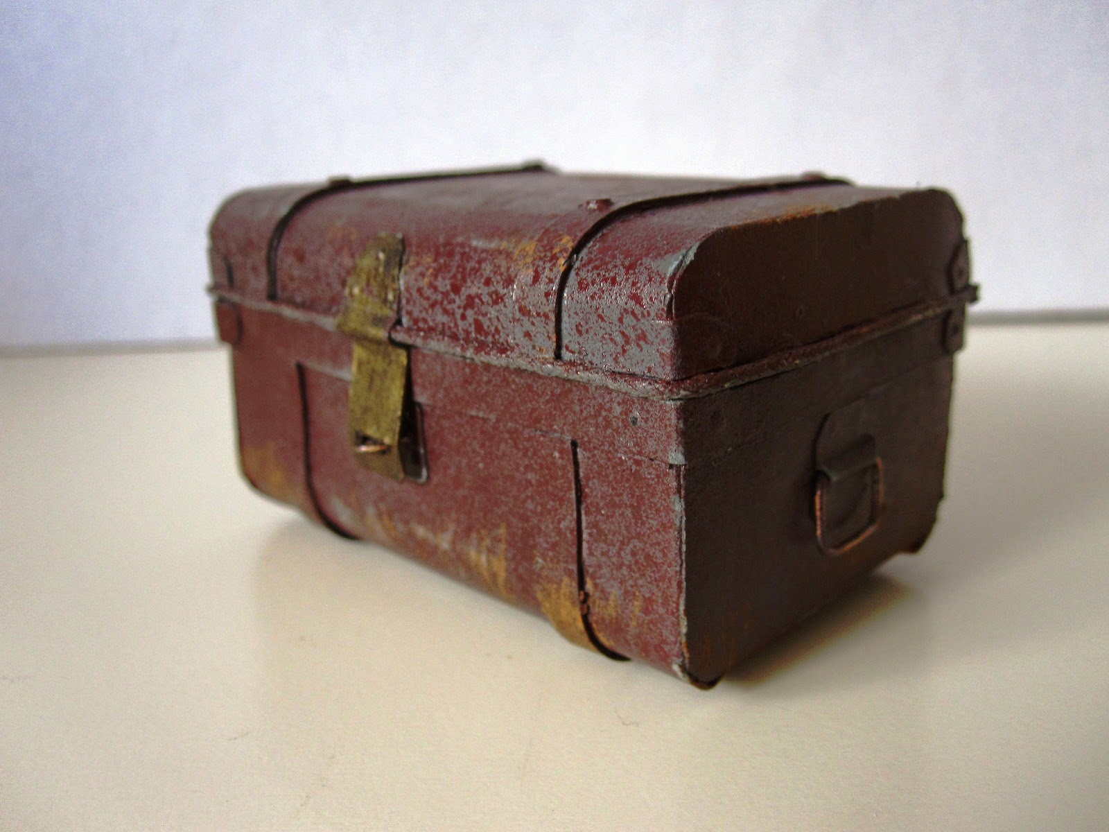 Miniature vintage tin trunk.