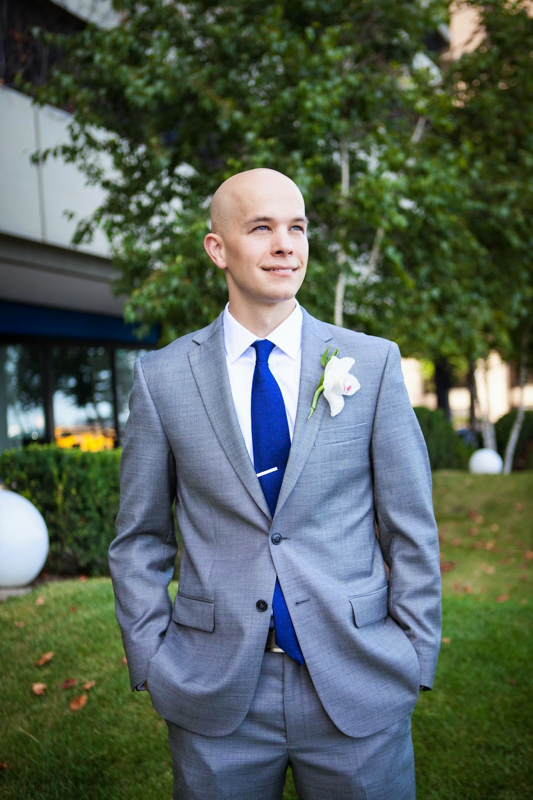 groom in gray suit and blue tie