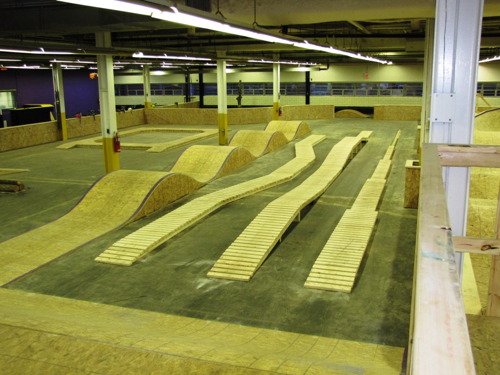 Backyard Wood Pump Track : Not real psyched on the particleboard, but has some good shapes