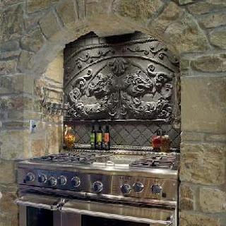 A gothic kitchen: the wall behind the stove is a decadent carved tile. Worth of a castle.