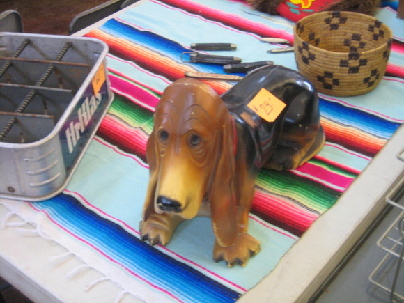 You're always going to find unique items like this dog figurine at the flea markets