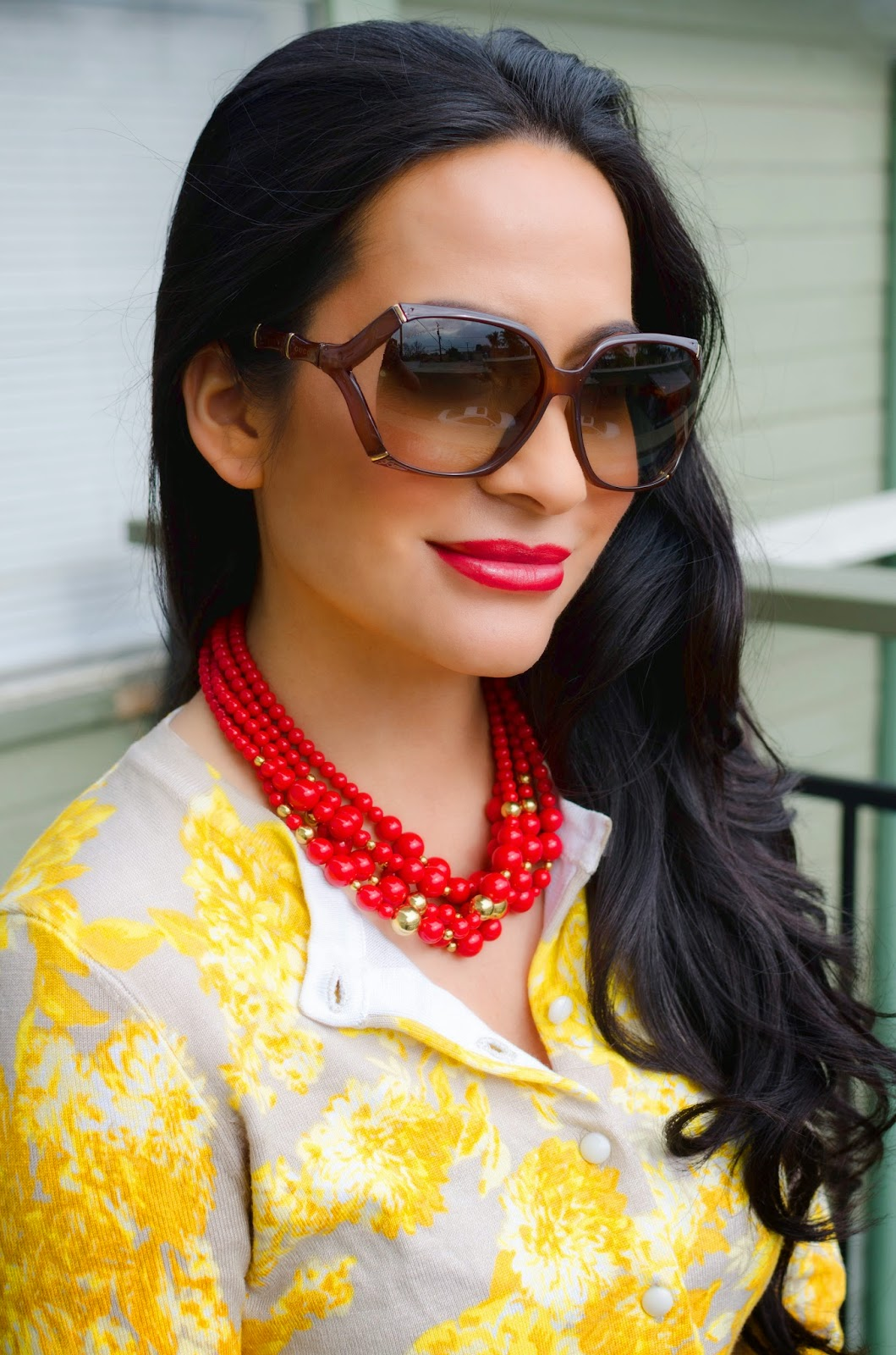 red and yellow sweater Gucci sunglasses Liz Claiborne necklace