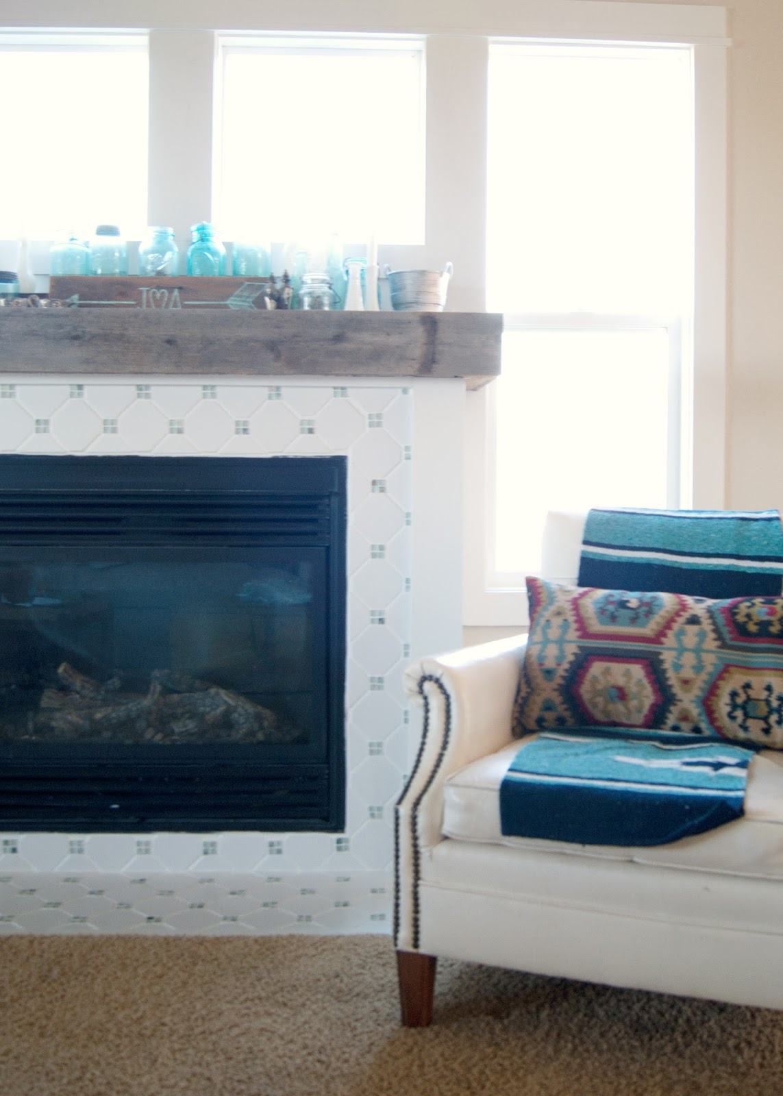 Fireplace Makeover - DIY Fireplace makeover using reclaimed and salvaged materials - octagon & dot tile, reclaimed wood,  white paint, planking - all for under $60! Before and After and links to all the steps!