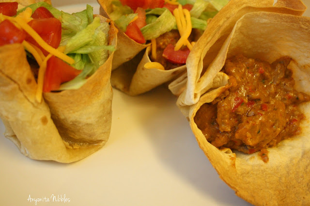 Two made and one unmade tostada rellena con carne adobada