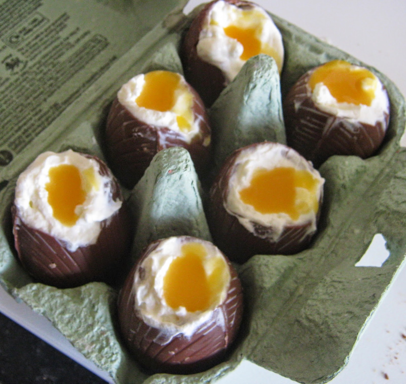 The cheesecake mixture and passion fruit yolks in the chocolate eggs