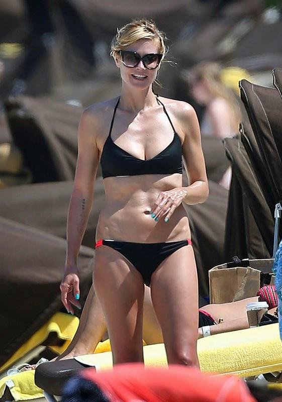 Heidi Klum in a strapless black bikini