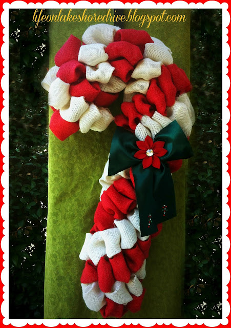 "alt=""Burlap Candy Cane Wreath Tutorial using Pool Noodle"""