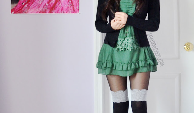 A cute fall/winter oufit featuring the Everything's Rosy faux knee sock tights from Idol Collective, Jeffrey Campbell Lita Spike platform booties dupes, and a fake two-piece black cardigan and green embellished tiered ruffle-hem dress.