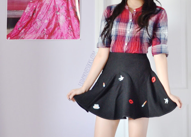 A cute, Korean fashion inspired fall outfit featuring a red plaid shirt and a black flared embroidered skirt/skort from Brandedkitty Shop.