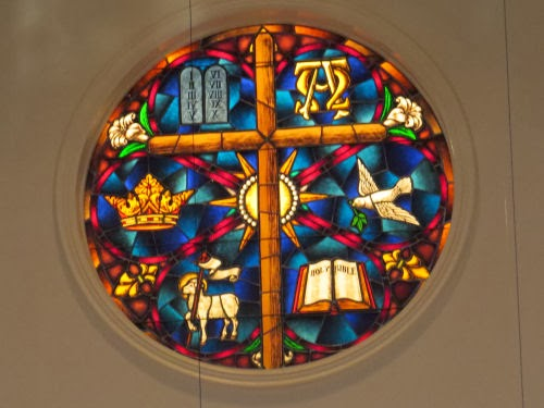 stained glass symbols of Jesus