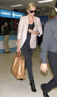 Spotted: Charlize Theron with Gucci Cruise 2011 bag