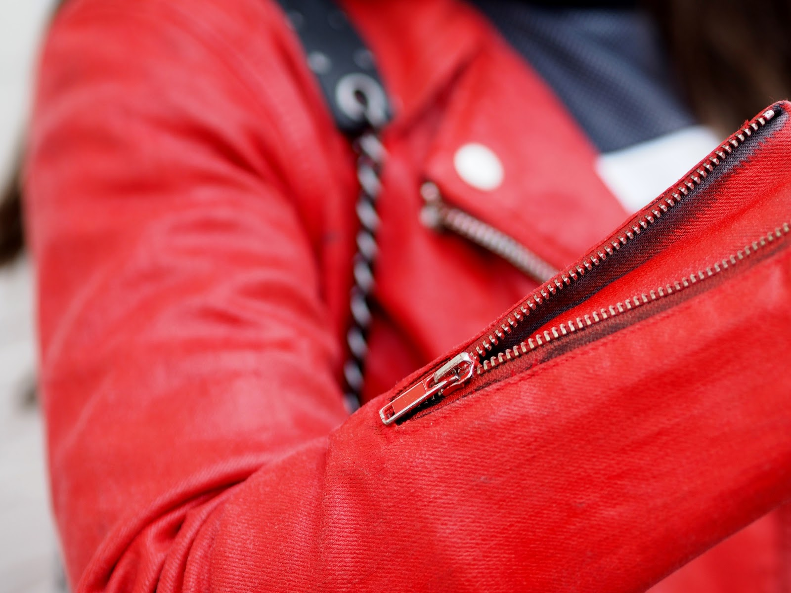 Detail shot red denim biker jacket by Levi's