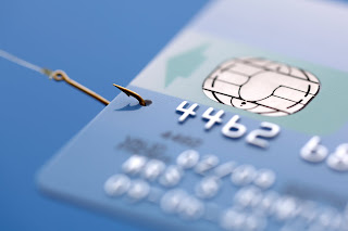Image of credit card with a fish hook in it.