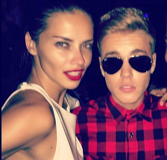 But why? Justin Bieber on their as Adriana's was snapped enjoying a night club moment in Cannes, France on Tuesday, May 20, 2014 after her split with husband, Marko Jaric in early May.