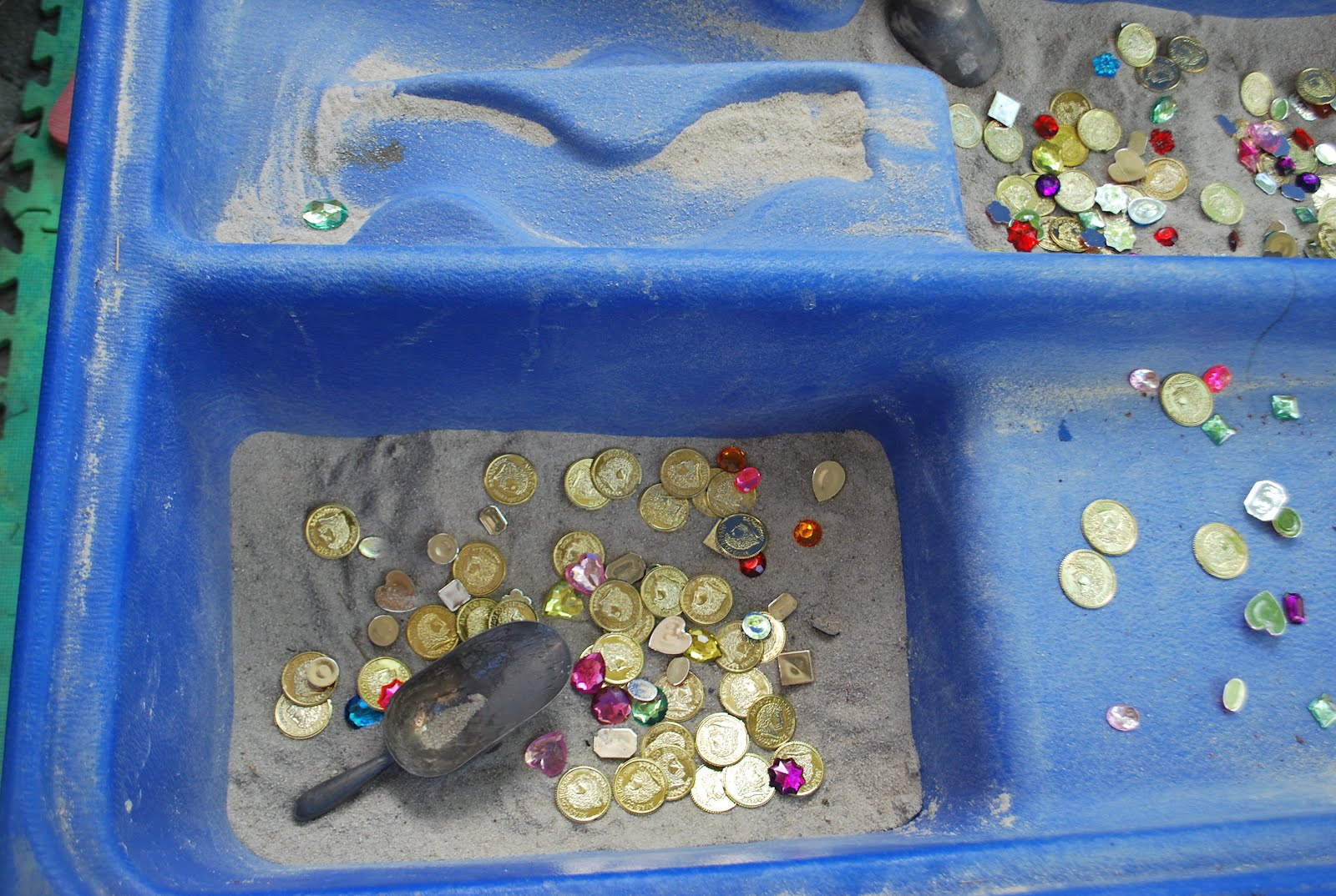 ideas to help get the kids into our sand table for some reason it always takes a back seat to the water table and slime tables and is very rarely used